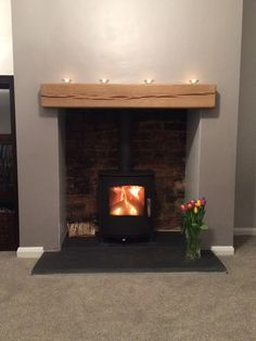 Mendip Churchill wood burning and multi fuel stove we installed in Bradford recently. We knocked out the customers chimney breast to reveal the original brick work at the back, supplied a slate hearth and oak beam. Wood Burner Fireplace, Fireplace Built Ins, Fireplace Hearth, Fireplace Surrounds, Fireplace Design, Fireplace Ideas, Slate Fireplace, Mantel Ideas, Decor Ideas