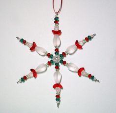 Beaded Snowflake Ornament ~ Sea Glass Christmas Ornament ~ Red, Green & Frosted White Sea Glass Guardian Angel Ornament ~ Angel Ornament by ItsaColorfulLife on Etsy https://www.etsy.com/listing/213138448/beaded-snowflake-ornament-sea-glass