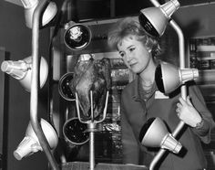 "That's one way to cook a turkey! A woman stands fascinated by the ""Barbecue King,"" an infra-red cooking unit on display at the United States Trade Center catering equipment exhibition in London."