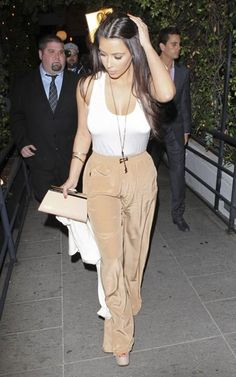 Perfection. Want some pants like these but I'm not sure I could pull it off! Although, Kim is my height and has big boobs like me....I bet I could rock it! #bustygirlproblems