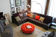 If the best floor plan solution is a sectional and chair, add color and texture with lots of pillows, rug and color. The tufted ottoman transforms into a table when you add a large tray.
