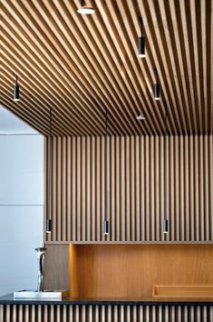 Delicate arches and simple cylinders in a family of lights which can be used singly or in clusters of brilliance. Aluminum heads with acrylic diffusers. Wood Slat Ceiling, Wood Slat Wall, Wooden Ceilings, Wood Slats, Wood Paneling, Ceiling Detail, Ceiling Design, Plafond Design, Wood Cladding