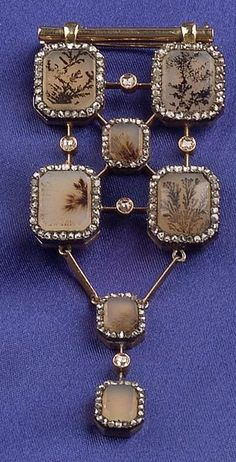 An antique dendritic agate, diamond, and gold brooch, possibly Russia, circa 1910.