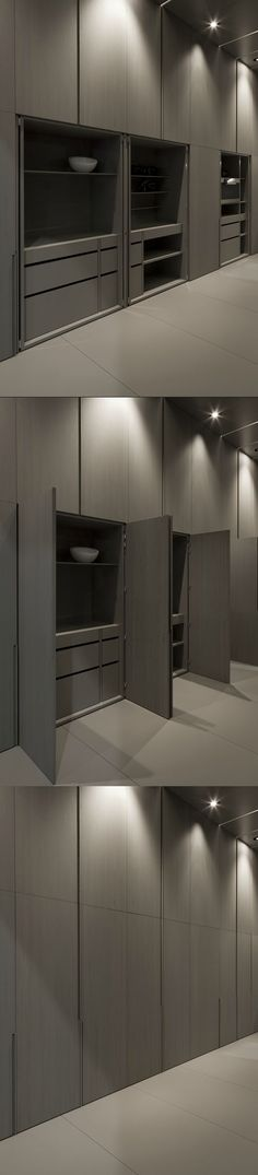 Wall with hidden cupboard inside the show kitchen at the Interieur 10 fair by…