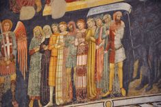 Different fabrics used in 14th century. - Fresco in Verona, Italy, 14th century