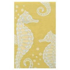 UV-resistant rug with a seahorse motif.   Product: RugConstruction Material: PolyesterColor: YellowFeatures: Suitable for indoor and outdoor useNote: Please be aware that actual colors may vary from those shown on your screen. Accent rugs may also not show the entire pattern that the corresponding area rugs have.Cleaning and Care: Spot clean with mild soap and water with a garden hose