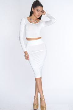 Your friends are used to seeing you in your signature corduroys, but their jaws drop when you enter the room in this stylish outfit. You cant help but smile as your friends compliment how beautiful you look! Featuring long sleeves, scoop neckline, cropped cut, and finished with a banded high waist skirt. 96% polyester 4% spandex.
