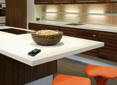 Corian countertop...not as good as granite or quartz but is still a good option with great patterns.  Note: embedded wireless phone charger in countertop...big thing for 2014.