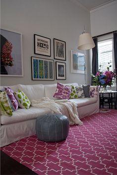 living room white sofa magenta rug