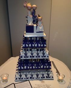 Purple and white wedding cake made up of individual mini wedding cakes - spectacular.  Checkout the cake topper characters, there's a bride and groom on a motorbike and their daughter looking cute as a button. Love this.  Suzanne Riley Marriage Celebrant