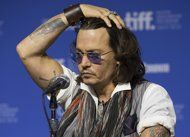 Damien Echols...The man Johnny Depp helped release from Arkansas' death row has become like a brother to him, right down to getting matching tattoos.