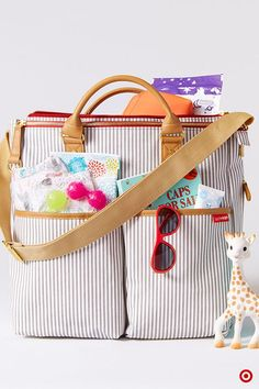 You've always had an eye for style, and being a mom won't change a thing! The Skip Hop Duo Special Edition Diaper Bag features an on-trend French stripe design with multiple compartments to hold all the essentials—diapers, wipes, baby bottles, bibs, snacks, toys and an included changing pad. Plus, there are pockets for keys, wallet, cell phone and lipstick. The bag also features a detachable shoulder strap and stroller clips. It's a must-have for your registry!