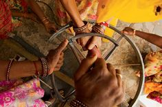 Women repair a solar cooker at India's Barefoot College, which has a six-month program that teaches rural women how to bring solar power to their villages. [Photo by Lana Slezic]