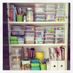 organized art cupboard for the kids