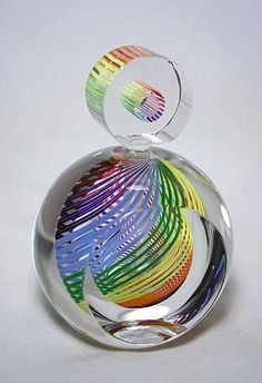 """Paul Harrie Striped Series, Rainbow Perfume Bottle, flat with round stopper. It comes artist signed Harrie and dated. Harrie Artglass sticker affixed #PH237C Rainbow. Approximately 4.87"""" x 3.42"""" x 2.65"""". Weight: 3.0 lbs."""