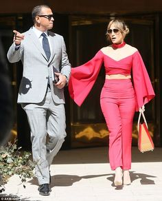 Ab fab: Meanwhile, she flashed her chiseled midriff and offered up a hint of cleavage in a scarlet off-the-shoulder crop top and matching slacks