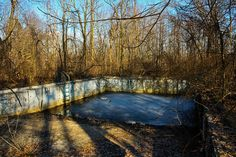 An old pool. Only holds rainwater now, but no one uses it. Lots of bodies burned here once.