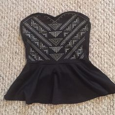 Blank studded tube top Flirty black studded tube top never worn Charlotte Russe Tops Tank Tops