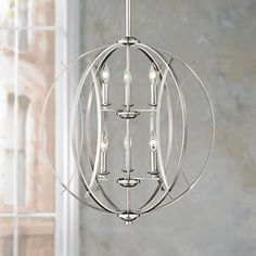 """Breathe new life into your contemporary home decor with a fascinating pendant light. This six light pendant light features a shining brushed nickel finish, intersecting lines that contrast the spherical shape beautifully and a touch of old world """"faux"""" candles complete the look. It is perfect for the decorating adventurous. -- Check this useful article by going to the link at the image. #homedecor101"""