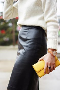 A leather skirt paired with a soft wool sweater is a perfect combination