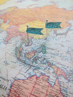 Easy DIY, use washi tape or ribbon cut into flags and pins.