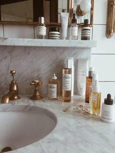 Cosmetics and jewelry on marble countertop in bathroom