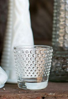 Glass votive holders are a great way to add interest to a table while creating a classic beautiful look