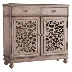 "Bring eye-catching style to your living room or den with this stylish chest, featuring openwork doors and a gray finish. Product: Che...  34.75"" H x 37"" W x 13"" D $525"