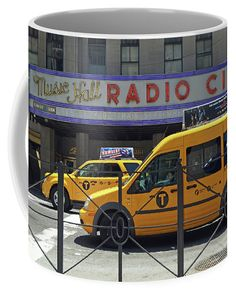 Radio City Music Hall coffee mug. Taxis line the street in front of the iconic Radio City Music Hall in New York City in this classic street scene. Exclusive design available only on Fine Art America and Pixels.com.  https://andrea-rea.pixels.com/