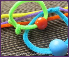 Pipe cleaners and beads make great threading practice!