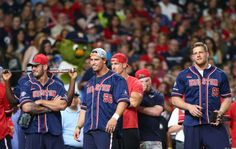 Houston Texans inside linebacker Brian Cushing (56) smiles as he watches Houston Texans punter Shane Lechler (9) bat during a homerun derby before the 4th annual J. J. Watt Charity Classic at Minute Maid Park Saturday, May 14, 2016, in Houston.