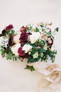 Gorgeous #bouquet for a #burgundy #wedding palette captured by @lovemintphotography #floralfriday