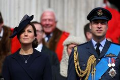 Paying attention: The Duke and Duchess of Cambridge stand to attention as the planes soar ...