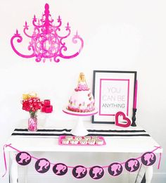 Main party table with cake and Barbie profile banner from a Glam Barbie Birthday Party at Kara's Party Ideas.