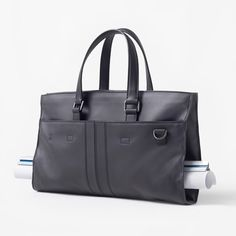 Nendo's Architect Bag for Tod's holds long drawings in its middle.