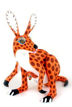 Luis Pablo is considered one of the top Oaxacan wood carving masters. ~~ There's even a joey in her pouch!