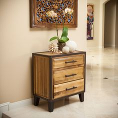 Made from acacia wood, this stand can double as both a storage and design element. With neutral colors and an industrial touch this cabinet will compliment any bedroom decor it is placed next to. $215.99