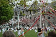 Maypole wrapping at Bryn Mawr College in Pennsylvannia in 2005. May Day festivities are an annual tradition at Bryn Mawr. Image Credit: Mike Goren via Wikimedia Commons