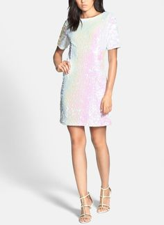 A sparkly white sequin dress for the 4th of July. Just add blue pumps and cute red clutch.