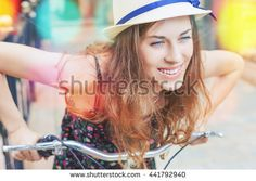 Summer and fun! Closeup woman riding by vintage city bicycle at the city center. It is like concept for activity and healthy lifestyle and environmentally friendly transport