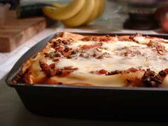 Classic lasagna recipe with ground beef, onion, Mozzarella, Ricotta, and Parmesan cheeses, tomato sauce and lasagna noodles.