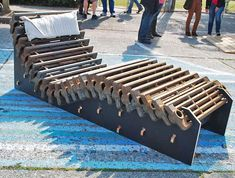 """The CNC Music Factory, an art collective, won first prize at the Seattle Design Jam for this lounge chair made from old cast iron radiators.""""Link -via Inhabitat. Furniture Showroom, Urban Furniture, Recycled Furniture, Street Furniture, Furniture Ads, Furniture Movers, Garden Furniture, Art From Recycled Materials, Recycled Art"""