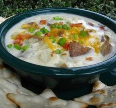 Scrumptious Baked Potato Soup  Ingredients 1/4 cup butter or 1/4 cup margarine 1/2 cup chopped onion 2 minced garlic cloves 1/4 cup all-purpose flour 1 (14 1/2 ounce) cans chicken broth 1 1/2 cups heavy cream 1 lb russet potato, baked ( about 3 medium) salt, to taste fresh ground black pepper, to taste 5 slices bacon, cooked and crumbled 3/4 cup shredded cheddar cheese sliced green onion Directions Melt butter in large heavy bottomed saucepan over medium heat. Add onion and garlic; cook, ...