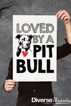 Are you loved by an adorable pit bull? Then this cute poster is for you! Available in several sizes and colors. Exclusive to Diverse Threads - https://diversethreads.com/products/loved-by-a-pit-bull-poster