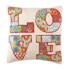 """Hand-hooked wool pillow with colorful typography.      Product: PillowConstruction Material: Wool cover and polyester fillColor: MultiFeatures: Insert includedDimensions: 18"""" x 18""""Cleaning and Care: Spot clean"""