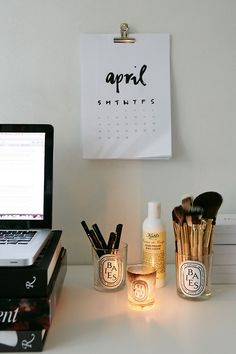 simple calendar, paies candle as brush holder, stack of books as computer desk