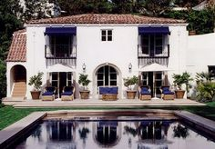 The Cobalt Blue Awnings looks quite nice with the Santa Barbara white stucco and matching cushions.