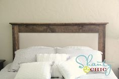 Oh, I kinda like this headboard too! The perfect combo of dark wood (for Tim!) and gorgeous fabric (for me!).