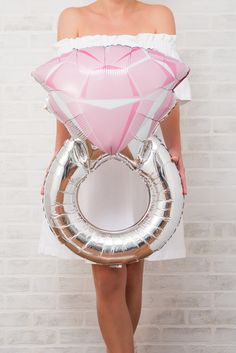 This Giant Engagement Ring - Party Decoration Balloon is a perfect addition to your bachelorette party decor!