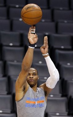 Oklahoma City's Russell Westbrook (0) shoots during warms up before  the NBA game between the Oklahoma City Thunder and the New York Knicks at the Chesapeake Energy Arena in Oklahoma City, Friday, Nov. 28, 2014.  Photo by Sarah Phipps, The Oklahoman